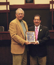 Tim Seeden is presented an award by the mayor